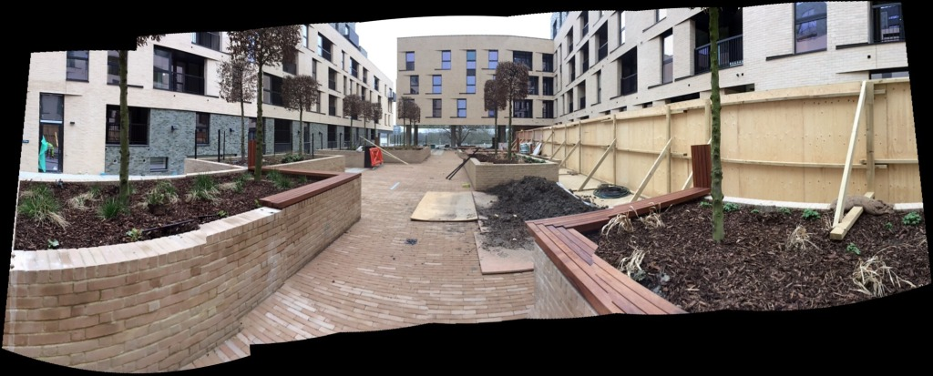 Genesis Housing Association. A view of the interior courtyard known as The Place, with embedded public art interpretation, taken during installation on site. Image: Christopher Tipping