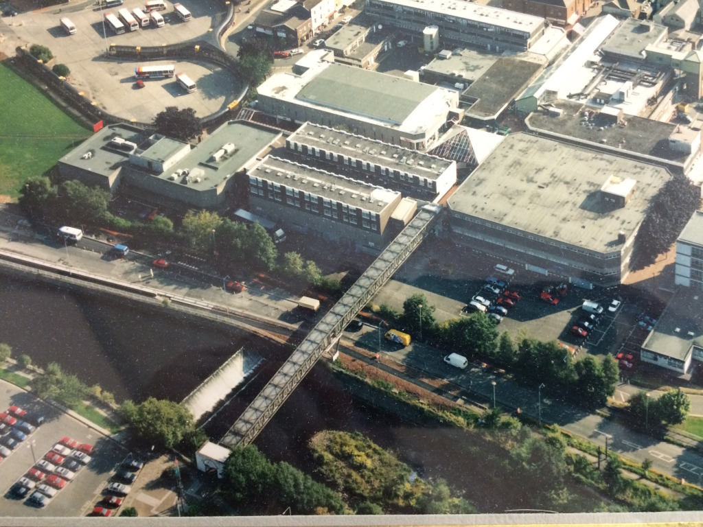Merthyr Tydfil Town Centre, circa 1980 showing the pedestrian link bridge across the River Taff. Image:  By permission of St Tydfil's Shopping Centre Manager.