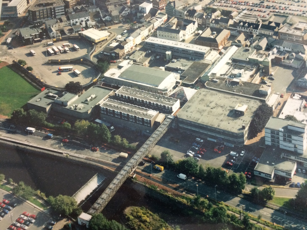 Merthyr Tydfil Town Centre, circa 1980 showing the Bus Station at the far left and the site of the new Bus Station just out of shot on the far right. Image:  By permission of St Tydfil's Shopping Centre Manager.