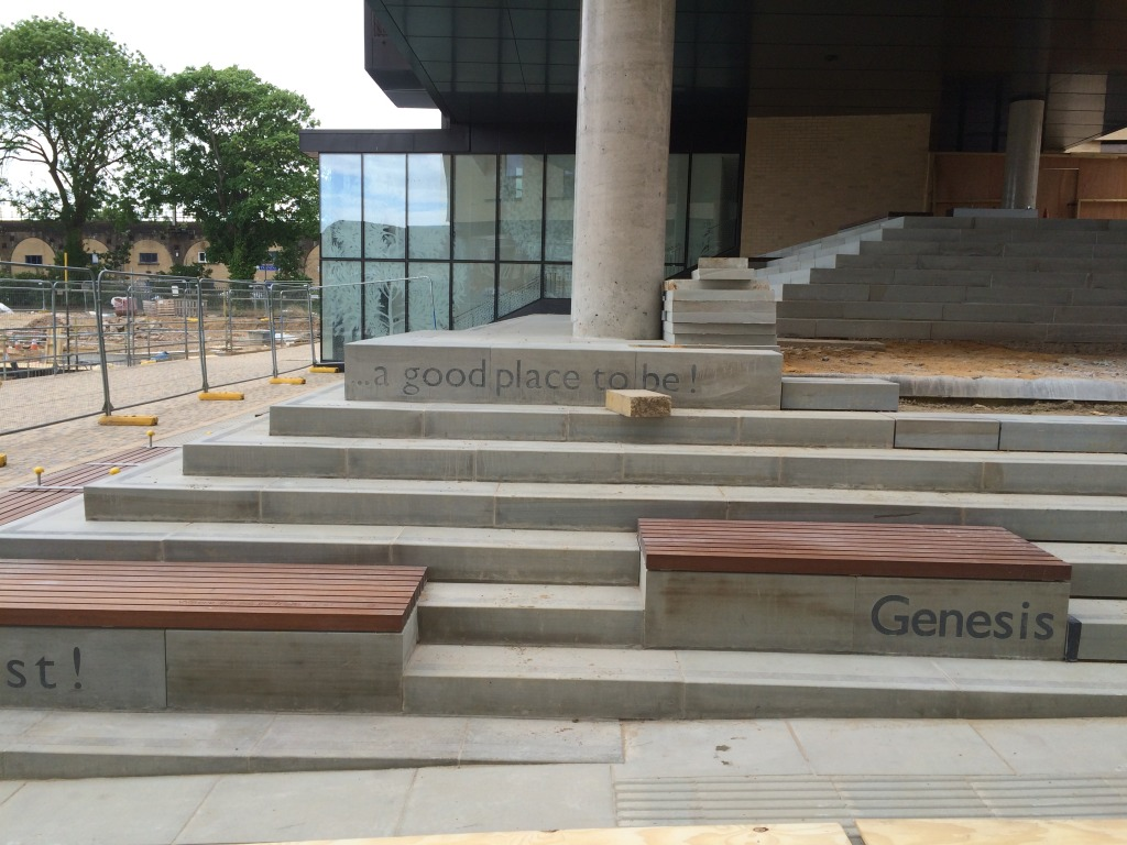 Central Chelmsford for Genesis Housing Association. Detail: Yorkstone steps with inset granite text - a part of the embedded public art interpretation - image taken during installation on site. Image: Christopher Tipping