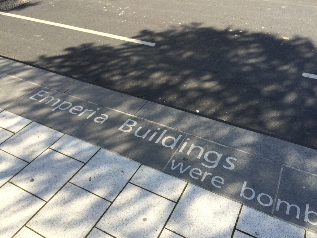 Station Quarter North, Southampton. 'Canal Shore' is a 205m long bespoke basalt kerb detail with inset granite text, running along Blechynden Terrace. Artist : Christopher Tipping
