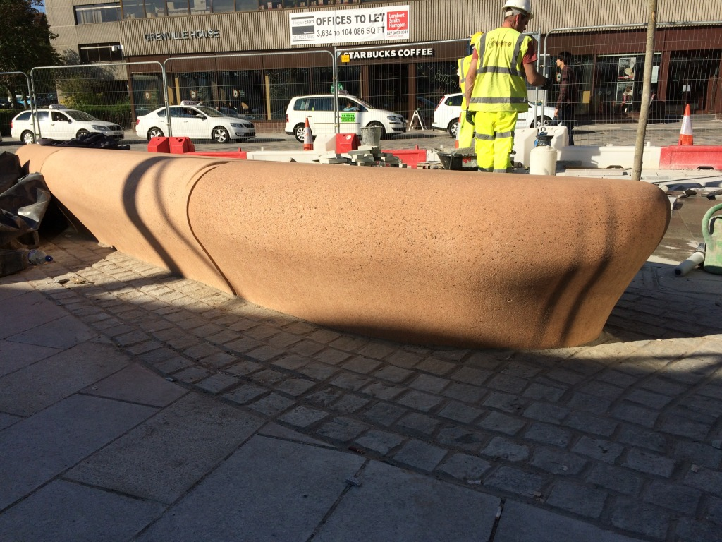Station Quarter North, Southampton. Bespoke four piece cast concrete radius bench during final installation on the Station Forecourt. Image:Christopher Tipping