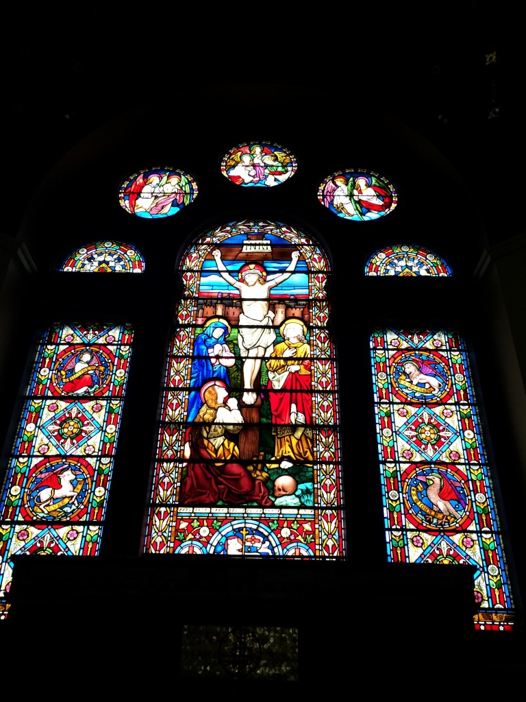 Interior of St John's Church, Railway Street, Chatham. Stained Glass window above the alter. Image: Christopher Tipping by permission Diocese of Rochester.